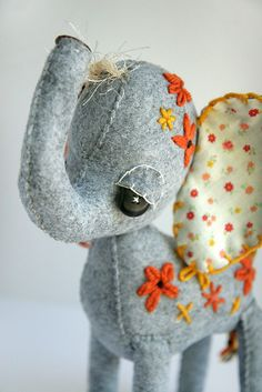 i have fallen head over heels for skunkboy creatures blog--she makes darling plushies, including this sweet elephant.