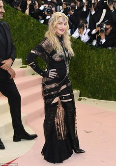 Fabulous at nearly 60!In keeping with the bondage theme, Madonna wore kinky thigh-high bo...