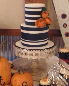 navy blue wedding cake with Fall flowers