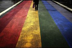A pedestrian walks across a painted rainbow crossing on Sydneys Oxford street, the citys main gay district April 4, 2013. Officials have ordered the removal of the rainbow crossing, setting off fierce debate in a city known for its annual Mardi Gras gay pride event, one of Australias main tourist draws. Lgbt News, Pedestrian Crossing, Sydney, David Gray, Oxford Street, Elements And Principles, Bild Der Tag, Lgbt Community, United Nations