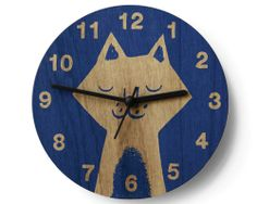 Wooden wall clock by Lisa Jones