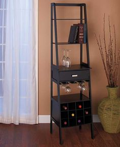 Black wooden Ladder Shelf Storage is a brilliant display idea for your home.  The 5-Tier Ladder Shelf offers roomy shelves to organize books, board games, DVDs