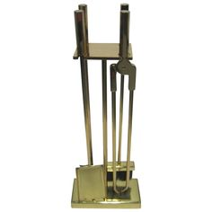 Offered by ANNE DITTMEIER | Vintage Modern Brass Fireplace Tool Set | From a unique collection of antique and modern fireplace tools and chimney pots at https://www.1stdibs.com/furniture/building-garden/fireplace-tools-chimney-pots/