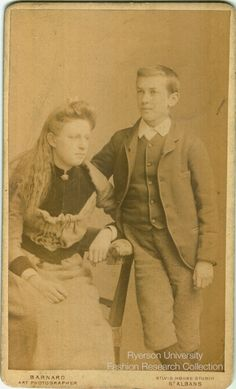 Boy Standing With Woman Sitting Photographed By John Barnard Of St Albans In