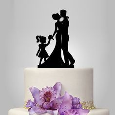 Bride Groom Silhouette Wedding Cake Topper,  acrylic Cake Decoration, family cake topper with little girl, funny ,unique topper by walldecal76 on Etsy https://www.etsy.com/listing/230221623/bride-groom-silhouette-wedding-cake