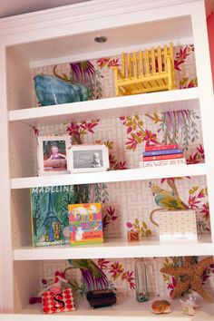 #DIY #wallpaper is an easy, fun way to spruce up a #bookcase in the #nursery or #playroom.
