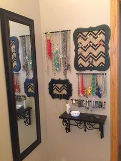 A fun and visually appealing way to display and organize your jewelry! My husband would be pleased to see this..