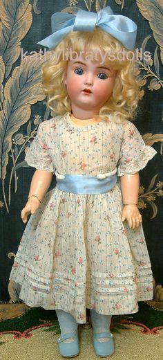 What a pretty doll dress--love the flowy, floral fabric! Inspiration for a pattern--Samantha, perhaps? Looks like it's from the Victorian era.