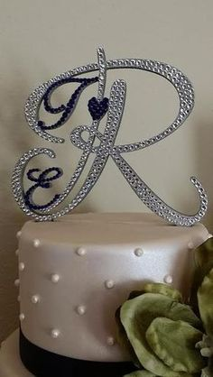 Custom Cake Topper for your wedding, birthday, anniversary, baby or bridal shower. You may purchase this listing for any letter you would like for your topper.