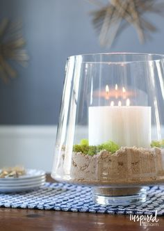 An inexpensive glass jar (from HomeGoods) plus sand and a candle can create a simple, yet beautiful centerpiece with sparkle. This is a chic ideas for any season or celebration. *sponsored pin*