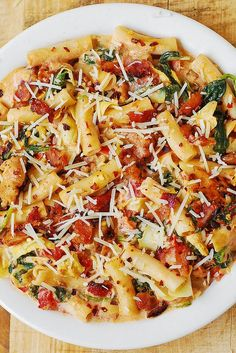 Spinach and Artichoke Chicken Pasta with Bacon and Tomatoes in Asiago Cream Sauce