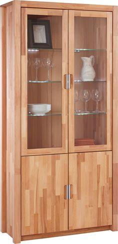 """Die Vitrine """"Leon"""" ist hochwertig und bringt ein natürliches Ambiente in Ihr Wohnzimmer: Möglich macht es die exzellente Verarbeitung aus massivem Kernbuchenholz. Die geölte Oberfläche wertet Ihr Möbel zusätzlich auf. Die furnierte Rückwand und die 5 Einlegeböden aus Glas ermöglichen ein stilvolles Präsentieren Ihrer Dekoideen hinter zwei gedämpften Glastüren. Der Clou: Die passende Beleuchtung ist bereits integriert. Zwei weitere Türen bieten zusätzlichen Stauraum - beispiel"""
