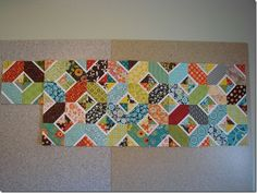 This is the 'Hugs and Kisses'  quilt I'm making with the scraps from Lesley's Retro flower quilt. It's coming along very nicely and I love it so far.  http://quiltingwithkristine.blogspot.com/2012/02/retro-flower-quilt-and-scrap-hugs.html