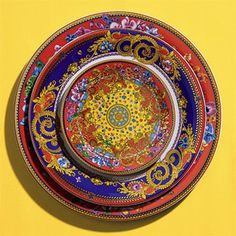 """""""Primavera"""" bread & butter plate, $50; dinner plate, $80; service plate, $195, all Versace for Rosenthal.- love the rich colors mixed with the ornate pattern"""