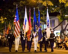 The U.S. Pacific Command joint service color guard marches down Kalakaua Avenue during the Pearl Harbor Memorial Parade at Fort Derussy Beach Park, Hawaii.