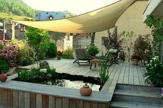 La terrasse au-dessus des toits : Terrasse couverte : les exemples imaginés par les lecteurs - Journal des Femmes Jardin