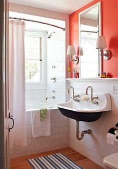 There is so much happening here: tile, hard wood, paneling, orange, deep basin sink - but somehow it all works.  I love this bathroom!