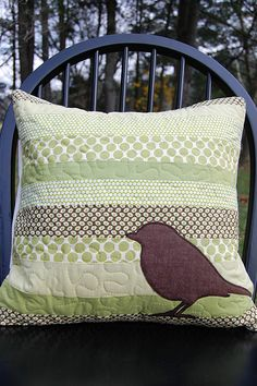 New pillow made with lots of greens pieced and free motion quilted. A little brown bird applique to finish it off!