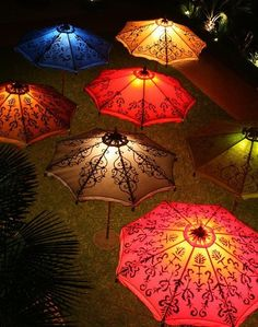 Love how these lighted umbrellas set such a lovely evening ambiance.