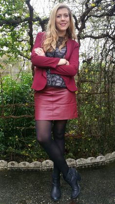 Amateur blonde modeling red leather skirt and black ankle boots