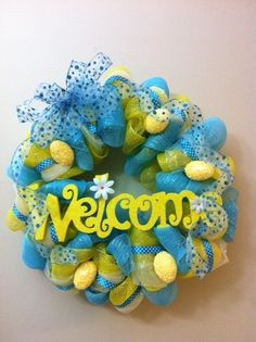 Welcome wreath.  Scrap the yellow eggs, add some brown.  Want to use for classroom door with my name for first days of school.