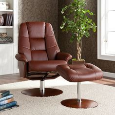 @Overstock - Relaxation takes on a whole new meaning when you find the most comfortable position in this adjustable leather recliner with ottoman. The butter-soft leather adds a polished look to the set that fits well in a den, study, or office setting.http://www.overstock.com/Home-Garden/Lewington-Cognac-Leather-Recliner-Ottoman/6842470/product.html?CID=214117 $359.99