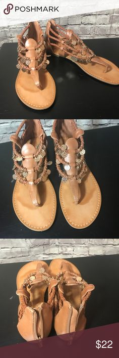 Jessica Simpson Griselda Gladiator Sandal Leather upper with braided straps at the ankle. They call the color of this sandal Light Luggage. The coins give the added decorative look. Jessica Simpson Shoes Sandals