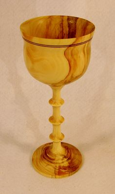 """Decorative turned wood goblet of Pinyon Pine. 7 3/4"""" by 3 3/8"""".  Finish is Danish Oil that has been buffed to a sheen.  Designed and turned by Bill Duane Brooks, Big Spring, Texas, July 2015."""