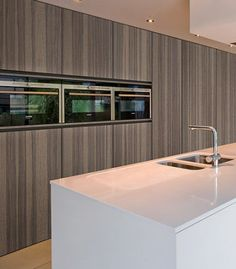 Here's another contemporary kitchen in Beverly Hills. The cabinets with no handles really add to the seamlessness of the space. It also has integrated appliances. Meaning that the refrigerator has to the same finish as the cabinets so it just looks like it part of the wall. Contemporary Kitchen Design, Studio, Beverly Hills, Refrigerator, Cabinets, Appliances, Space, Home Decor, House