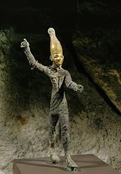 """2ND-1ST MILL.BCE. Semitic god Ba'al of the thunderstorm, gilded bronze idol, with an Egyptian-style crown. From  the port of Ugarit (Ras Shamra, Syria).  Can refer to any number of local deities, each regarded in the Hebrew Bible in that context as a """"false god"""". The Ba'al cult was the greatest and most enduring threat to (monotheism) the exclusive worship of Yahweh among ancient Israelites. Islam also warned against the worship of Ba'al. Louvre"""