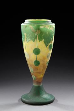 """DAUM NANCY baluster shaped vase lined yellow and green glass decorated with clear chestnut leaf acid. Signed """"Daum Nancy"""" and cross of Lorraine under the base at the center. Circa 1900."""