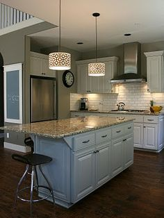 Love this white kitchen with dark wood floors. My plan is to use a sideboard, buffet or dresser as the island on wheels.