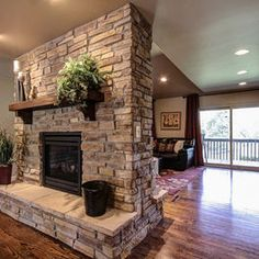 gray stacked stone fireplace with black hearth design ideas rh pinterest com