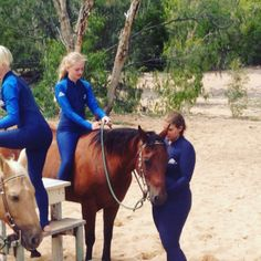 Horse riding in the ocean at horse shoe bay