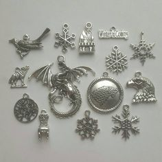 14pcs Game of Thrones Theme Tibetan Silver Charms pendants for jewellery making Including dragon, Castle, Winter is Coming, Snow, Raven Wolf
