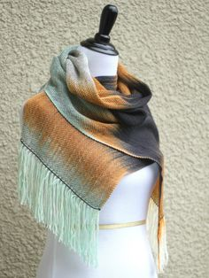 """Hand woven long scarf with gradually changing colors from white to orange, black and light mint. Amazing color shades and color variety. Measures: L: 78"""" with 6"""" fringe on ... #kgthreads"""