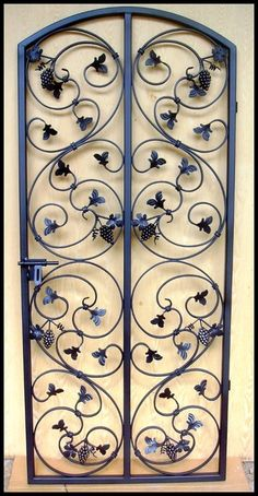 Handcrafted artistic iron wine cellar doors. Secure your wine cellar in style with one of my custom iron wine cellar doors and gates. I use grapevine designs, hand forged wrought iron scroll designs. I can custom build gates to fit in your current opening. Get it built by Leo! Металлические Ворота, Кованые Железные Ворота, Железные Садовые Калитки, Стальные Двери, Входные Двери, Железные Двери, Ворота В Сад, Двери Из Кованого Железа, Художественная Ковка