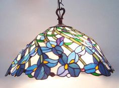 I'd love one of these Tiffany style lamps would hanging over a table in a breakfast nook...
