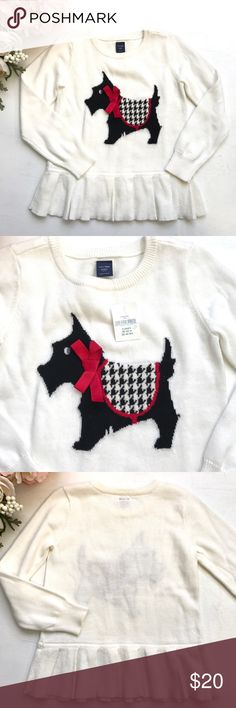 """Baby Gap Pleated Scottie Dog Peplum Sweater Top An adorable little Scottie with a sweater and bow adorn this NWT cream/off white colored sweater Top from Baby Gap! Cuffed sleeves, pleated peplum bottom. Size 4 yrs 39-43""""/36-49lbs.  100% cotton and machine washable GAP Shirts & Tops Sweaters"""