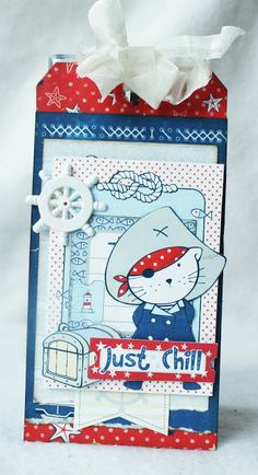 ScrapBerry's: Beautiful tag for a kid made with the Zoe & Ziggy's Sailing Adventures collection and a cute pirate cat. Made by Romy Veul.