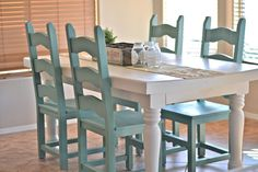 The white is Swiss Coffee by Glidden and the chairs are spray painted in Jade by Krylon