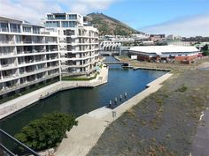 410 Harbour Bridge - This is a modern self-catering apartment situated on the top floor of Harbour Bridge, boasting beautiful views of Signal Hill and the Docks.  The apartment features air-conditioning, one bedroom, a full ... #weekendgetaways #vandawaterfront #southafrica