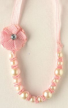 Today I am going to show you how you can create a cute, very easy Gingham and Pearl necklace for you or that little gal in your life.