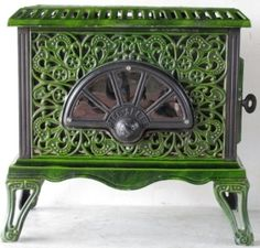 Art Nouveau style log burner by the famous French company Pied Selle, circa 1920.
