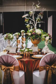Chocolate Lily Floral Design www.chocolatelilyfloral.com & Charming Decor Event Rentals & Design www.charmingdecor.ca designed this gorgeous feature table for the Victoria Bridal Exhibition Jan 19th2014 Photo credit: Ashley and Brandon Photography www.ashleyandbrandonphotography.com