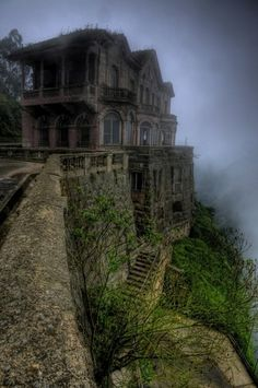 Abandoned Hotel Del Salto in Colombia. Built off the edge of a cliff in 1928 with a view of the Tequendama Falls, it was not uncommon for people to commit suicide. To this day people claim to see silhouettes in the fog.