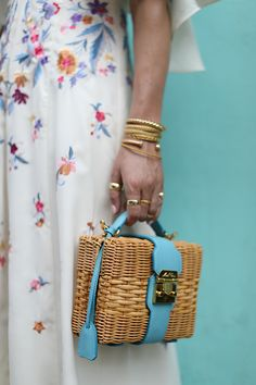 A Mark Cross basket bag and white floral skirt in Cartagena