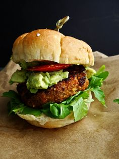 Maple Chipotle Sweet Potato Burger topped with avocado. We're drooling at our desks too!