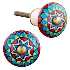 An artsy knob instantly updates a cabinet or dresser. Ceramic geometric multicolor knob.  Cute idea to spruce up some dressers!