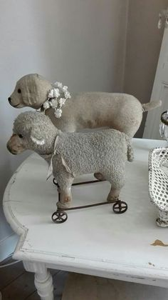 Adorable antique dog and sheep pull toys